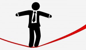 http://www.dreamstime.com/royalty-free-stock-photography-symbol-business-man-walks-danger-risk-tightrope-image7183517